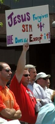 christian holding sign declaring Jesus doesn't 'except' homosexuality